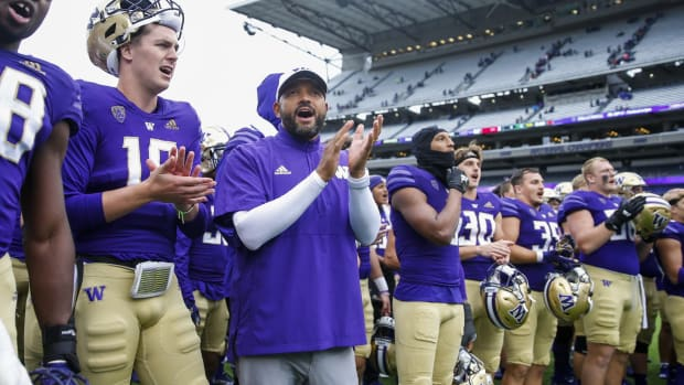 Jimmy Lake and his team sing the UW fight song.