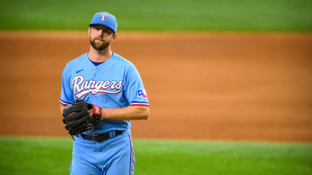 Sep 19, 2021; Arlington, Texas, USA; Texas Rangers starting pitcher Jordan Lyles (24) reacts to being pulled from the game against the Chicago White Sox during the fourth inning at Globe Life Field.