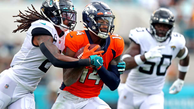 Denver Broncos wide receiver Courtland Sutton (14) makes a catch Jacksonville Jaguars defensive back Rayshawn Jenkins (2) during the second quarter at TIAA Bank Field.