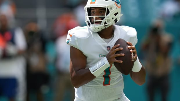 Sep 19, 2021; Miami Gardens, Florida, USA; Miami Dolphins quarterback Tua Tagovailoa (1) attempts a pass against the Buffalo Bills during the first half at Hard Rock Stadium.