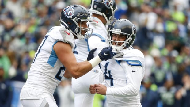 Tennessee Titans kicker Randy Bullock (14) celebrates with tight end Geoff Swaim (87) after kicking a game-winning field goal in overtime against the Seattle Seahawks at Lumen Field.