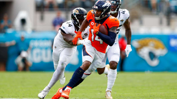 Denver Broncos wide receiver Courtland Sutton (14) runs with the ball against Jacksonville Jaguars middle linebacker Myles Jack (44) in the third quarter at TIAA Bank Field.