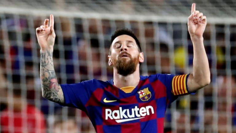 Messi Free Kick Helps Barcelona Rout Sevilla