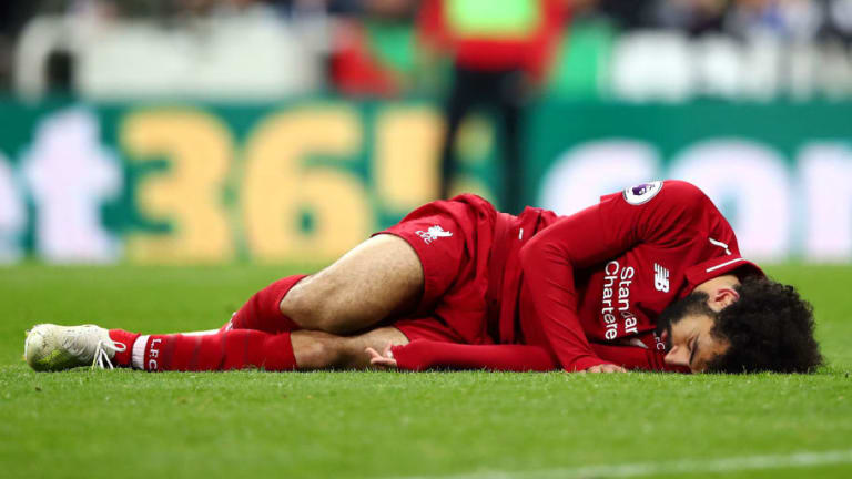 Mohamed Salah Forced Off on Stretcher After Picking Up Head Injury Against Newcastle United