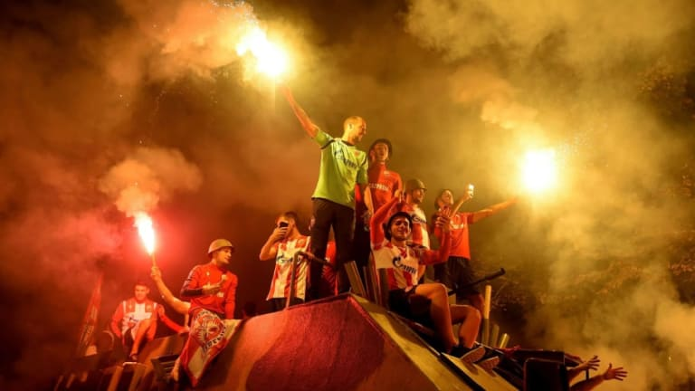Red Star Belgrade Players Ride Army Tank During Wild Celebrations After Champions League Win