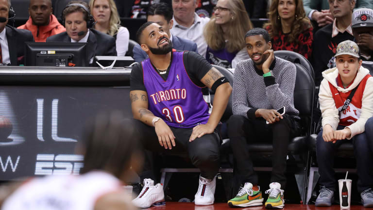 Friday's Hot Clicks: Drake Awkwardly Covered Up His Warriors Tattoos During Game 1