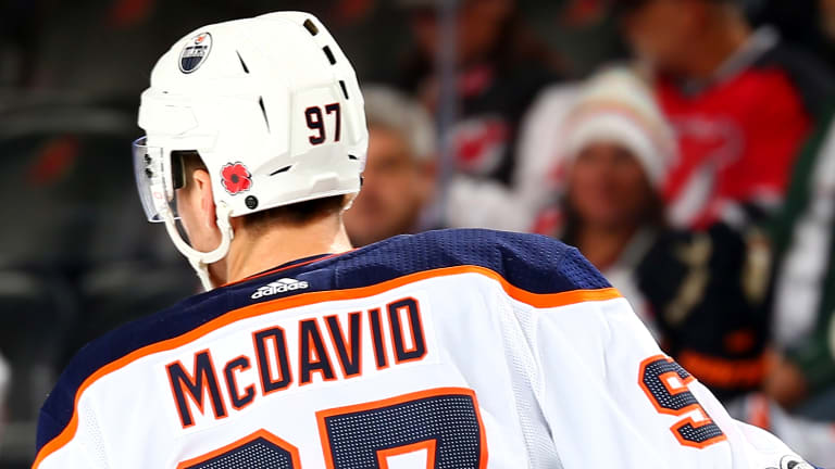Connor McDavid's Signature Forged on Oilers Jerseys