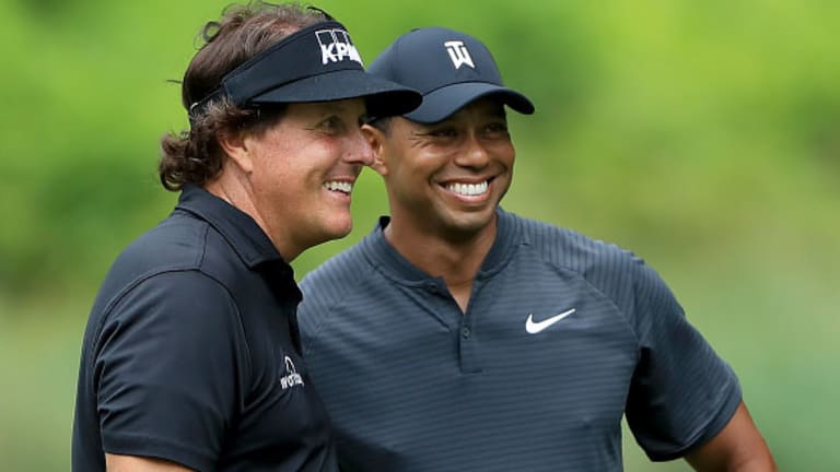 Watch: Tiger Woods and Phil Mickelson Go Head-to-Head in Game of 'Golf Pong'