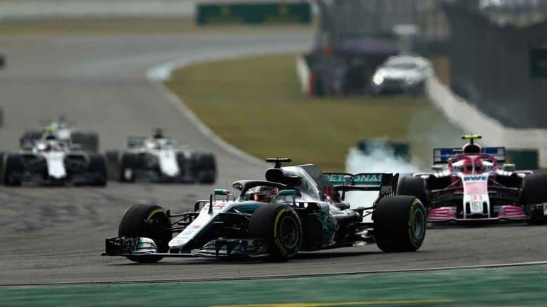 Lewis Hamilton Wins German GP as Rival Sebastian Vettel Crashes Late On