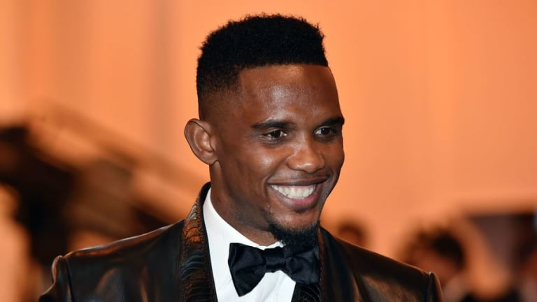 Former Chelsea & Barcelona Striker Samuel Eto'o Mobbed at Airport as He Jets in to Sign for New Club