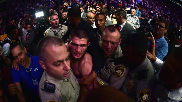 Watch: Khabib Nurmagomedov Jumps Octagon Fence, Chaos Erupts as UFC 229 Turns Into Brawl