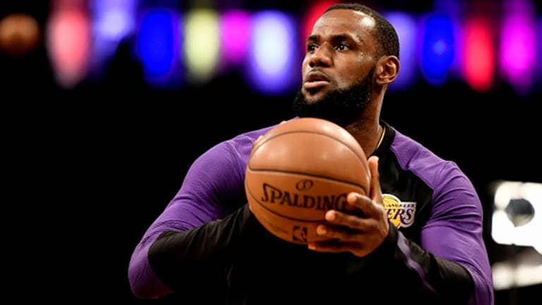 Watch: LeBron James Takes Selfie With Fan After Lakers' Loss vs. Nets