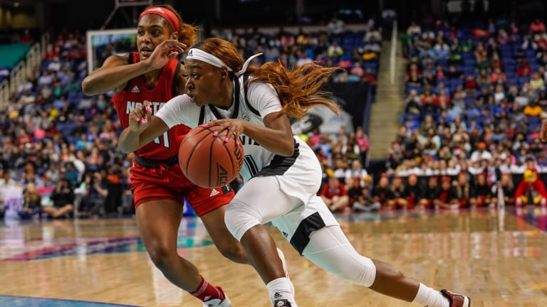 Louisville holds off Syracuse rally for conference win