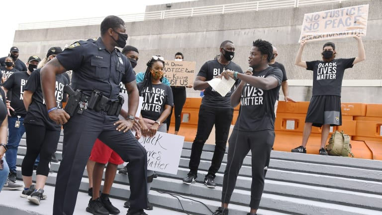 Former Virginia Tech Wide Receiver Ernest Wilford Making a Difference as Police Officer in Jacksonville
