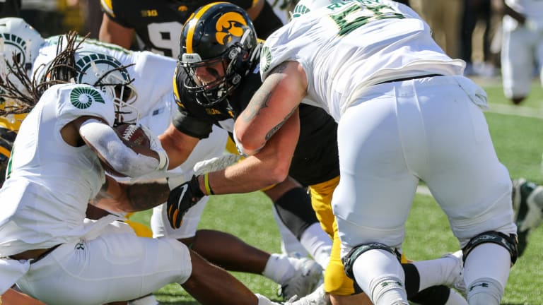 Game Story: At Less Than Its Best, Iowa Fends Off Colorado St.