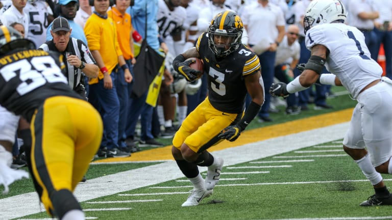 Hawkeyes Survive Penn State, Field Storm
