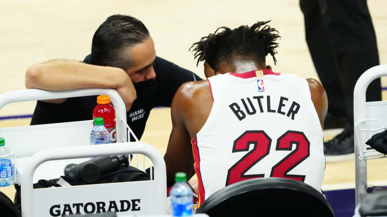 Miami Heat's Jimmy Butler `OK' After Rolling Ankle in Loss to Phoenix Suns