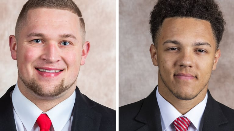 Two Football Huskers Make Academic All-District Team