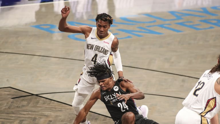 Charlotte Hornets acquire Wes Iwundu, Tyler Harvey and cash considerations for Devonte' Graham in three-team deal