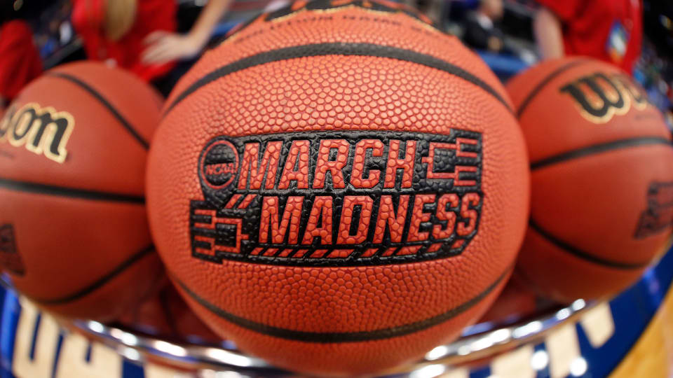March Madness logo on a basketball