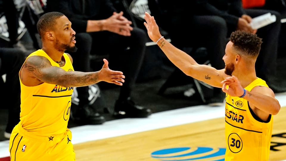 Team Lebron guard Damian Lillard of the Portland Trailblazers (27) and Team LeBron guard Stephen Curry of the Golden State Warriors (30) celebrate during the 2021 NBA All-Star Game