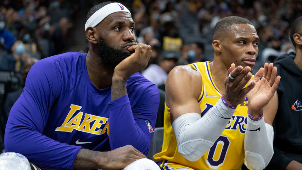 Los Angeles Lakers forward LeBron James (6, left) and guard Russell Westbrook (0) sit on the bench during the fourth quarter.