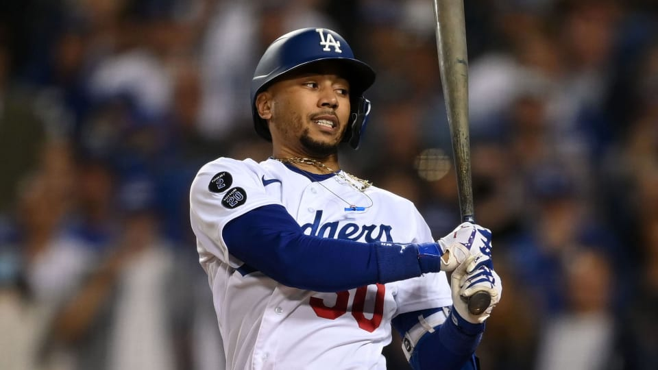 Los Angeles Dodgers right fielder Mookie Betts (50) strikes out in the eighth inning against the Atlanta Braves during game four of the 2021 NLCS at Dodger Stadium.