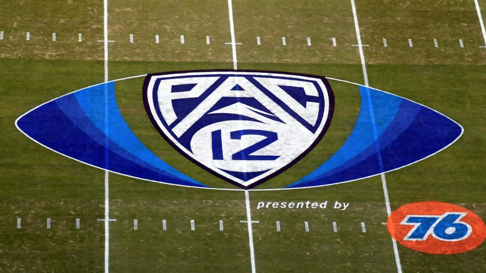 Pac-12 logo sits on a football field