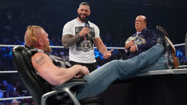 Brock Lesnar and Roman Reigns during their contract signing on SmackDown