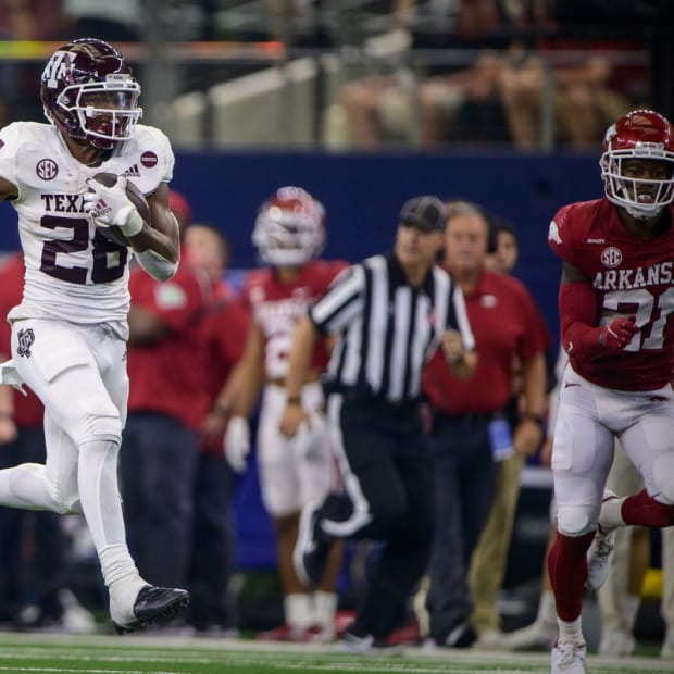 Sep 25, 2021; Arlington, Texas, USA; Texas A&M Aggies running back Isaiah Spiller (28) runs for a touchdown against the Arkansas Razorbacks during the second half at AT&T Stadium. Mandatory Credit: Jerome Miron-USA TODAY Sports