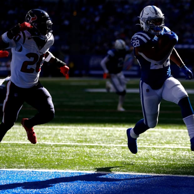 Houston Texans safety Justin Reid (20) chases after Indianapolis Colts running back Jonathan Taylor (28) as he rushes for a touchdown Sunday, Oct. 17, 2021, during a game against the Houston Texans at Lucas Oil Stadium in Indianapolis.