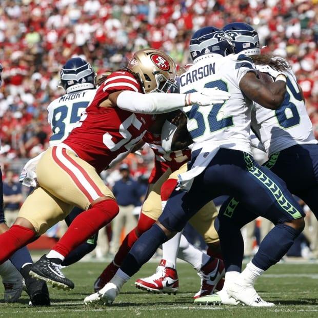 Oct 3, 2021; Santa Clara, California, USA; San Francisco 49ers middle linebacker Fred Warner (54) tackles Seattle Seahawks running back Chris Carson (32) during the second quarter at Levi's Stadium. Mandatory Credit: Darren Yamashita-USA TODAY Sports