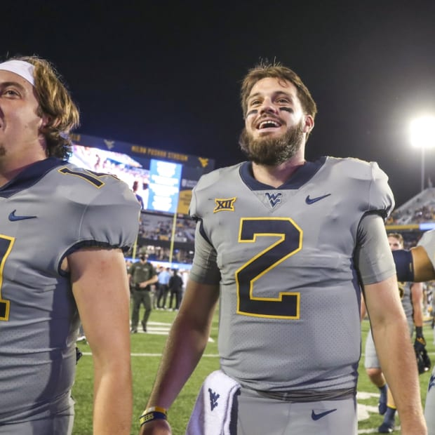 Sep 11, 2021; Morgantown, West Virginia, USA; West Virginia Mountaineers quarterback Jarret Doege (2) celebrates with teammates after defeating the Long Island Sharks at Mountaineer Field at Milan Puskar Stadium. Mandatory Credit: Ben Queen-USA TODAY Sports