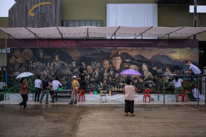 At the cave site, a huge artists' mural honorsthe team and rescue heroes.