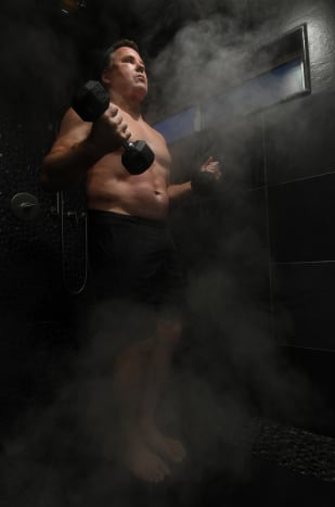 Plummer does midnight workouts in a 120-degree steam shower in his home.