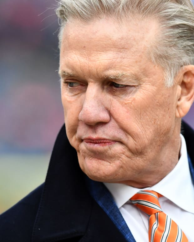 Denver Broncos general manager John Elway looks on before a game against the Los Angeles Chargers at Broncos Stadium at Mile High.