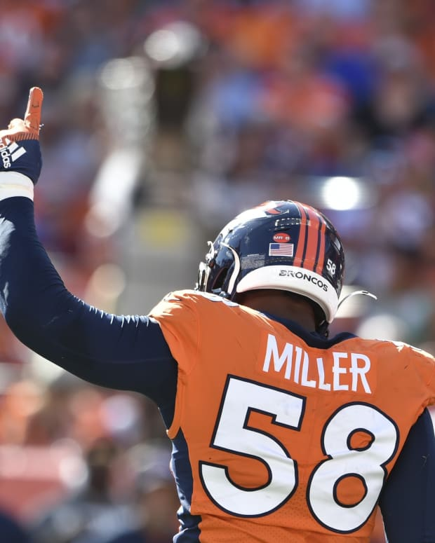 Denver Broncos outside linebacker Von Miller (58) celebrates his 100th career sack at Empower Field at Mile High.