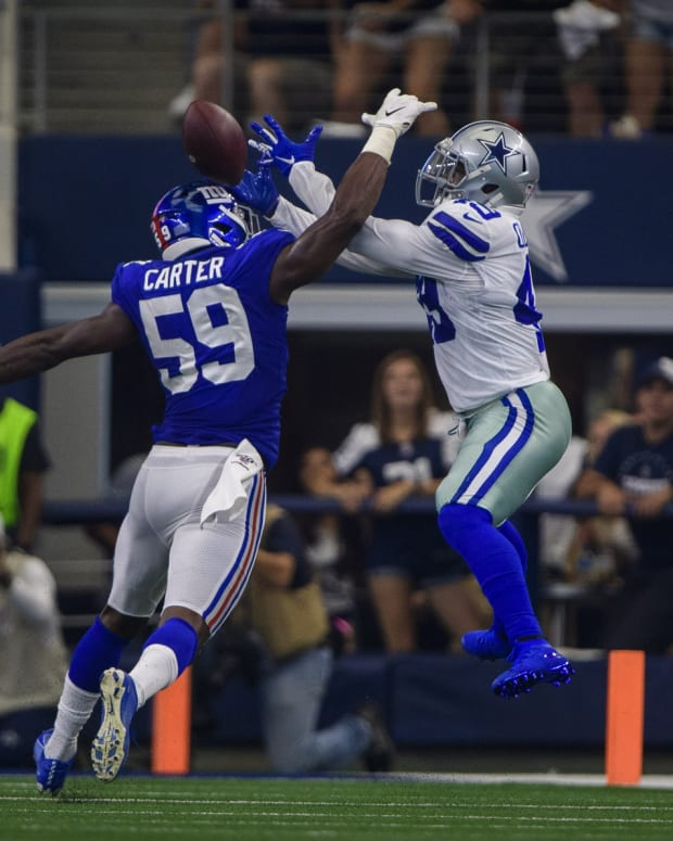 Sep 8, 2019; Arlington, TX, USA; New York Giants linebacker Lorenzo Carter (59) breaks up a pass intended for Dallas Cowboys running back Jamize Olawale (49) during the second quarter at AT&T Stadium.
