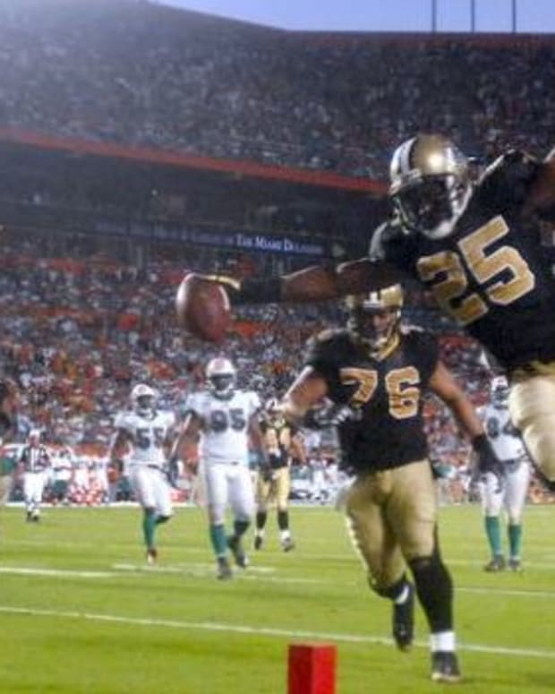 Oct 25, 2009 ; Miami Gardens, FL, USA; New Orleans Saints running back Reggie Bush (25) leaps across the goal line for a touchdown against the Miami Dolphins during the fourth quarter of a game at Sun Life Stadium in Miami Gardens, Florida. Mandatory Credit: Steve Mitchell-USA TODAY Sports