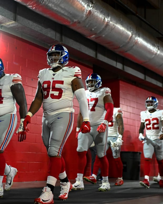 Sep 22, 2019; Tampa, FL, USA; New York Giants defensive end Dalvin Tomlinson (94) and defensive end B.J. Hill (95) walk through the tunnel prior to the game between the Tampa Bay Buccaneers and the New York Giants at Raymond James Stadium.