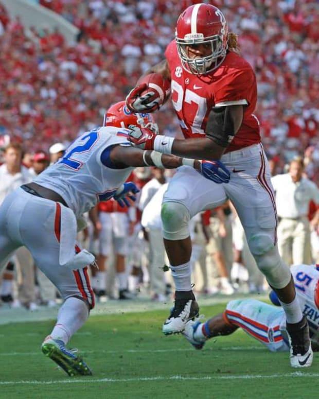 Alabama running back Derrick Henry breaking tackles against Florida