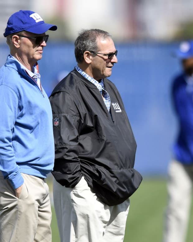 May 11, 2018; East Rutherford, NJ, USA; New York Giants owner John Mara (left) and general manager Dave Gettleman on the field during rookie minicamp at Quest Diagnostics Training Center on Friday.