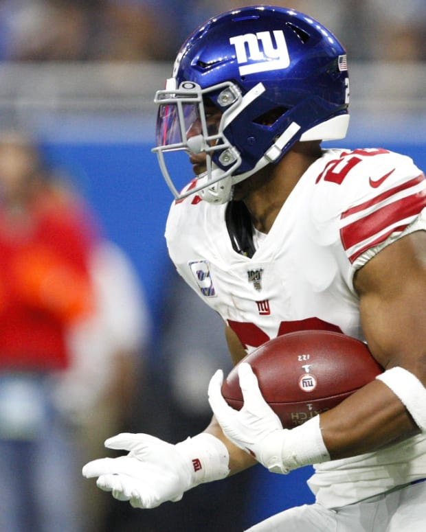 Oct 27, 2019; Detroit, MI, USA; New York Giants running back Saquon Barkley (26) runs the ball during the first quarter against the Detroit Lions at Ford Field.