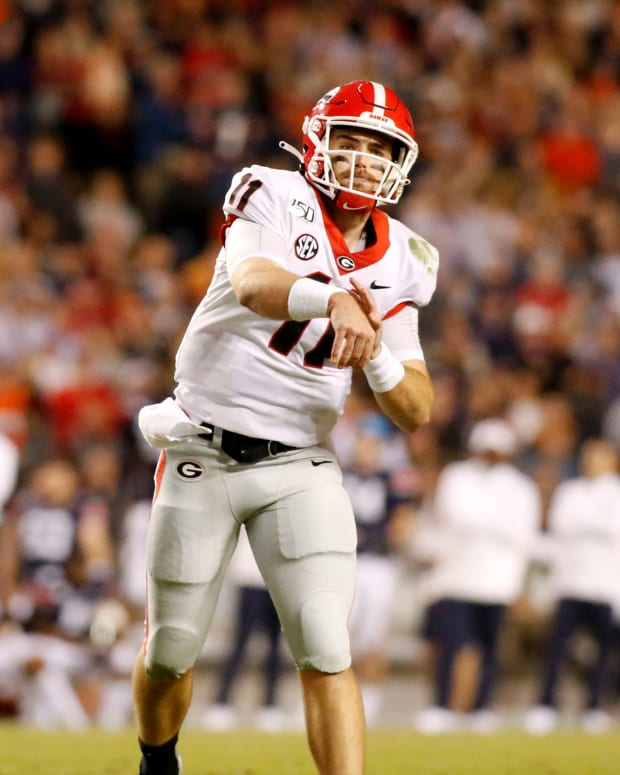 Nov 16, 2019; Auburn, AL, USA; Georgia Bulldogs quarterback Jake Fromm (11) throws a pass against the Auburn Tigers during the third quarter at Jordan-Hare Stadium. Mandatory Credit: John Reed-USA TODAY Sports