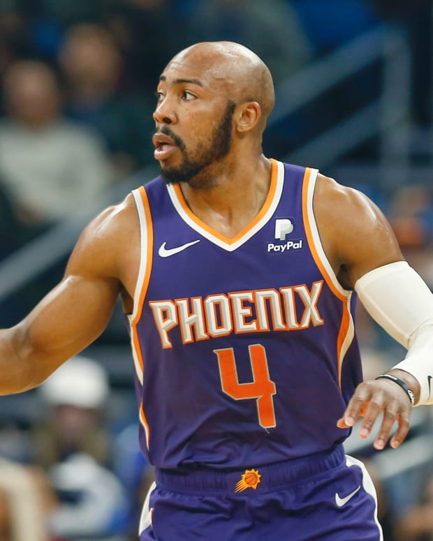 Phoenix Suns guard Jevon Carter (4) brings the ball down court during the second half against the Orlando Magic at Amway Center.