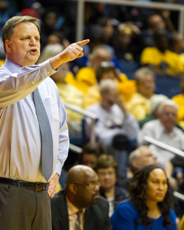 West Virginia Mountaineers head coach Mike Carey reacts on the sidelines during the second half against the Baylor Bears at WVU Coliseum.
