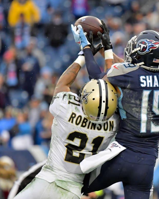 Saints Patrick Robinson prevents a touchdown by Titans Sharpe