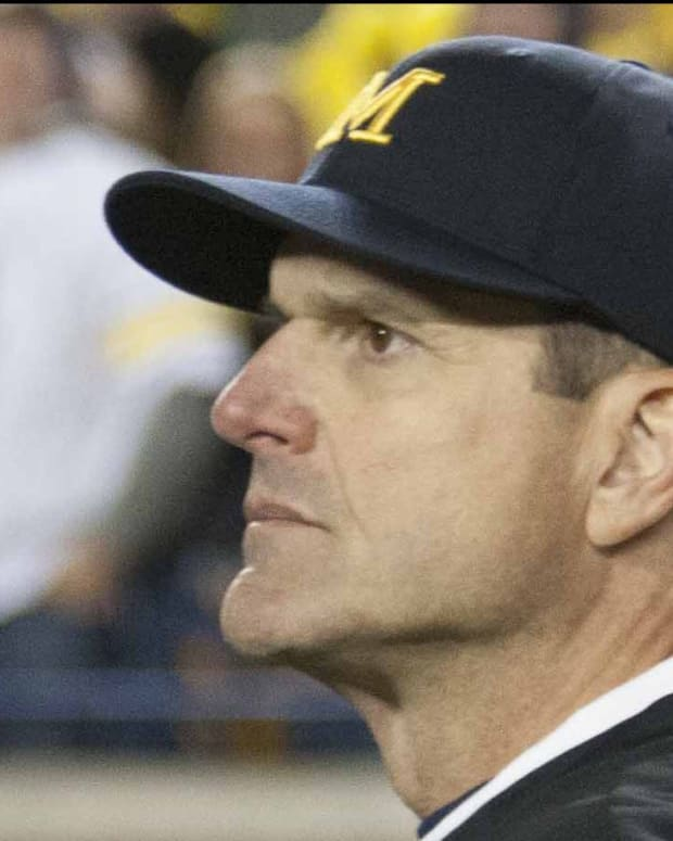 Jim Harbaugh stood shocked as the MSU Spartans beat his Wolverines on a last second play in 2015.  Photo courtesy of Starr Portice.