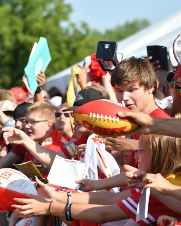 Jul 27, 2019; Kansas City, MO, USA; Kansas City Chiefs quarterback Patrick Mahomes (15) signs autographs for fans after training camp at Missouri Western State University. Mandatory Credit: Denny Medley-USA TODAY Sports
