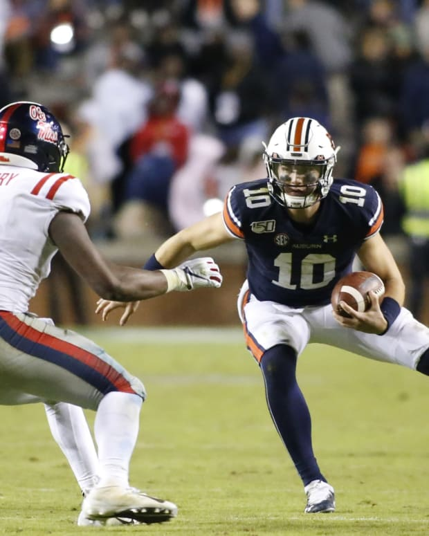 Mississippi Rebels linebacker Lakia Henry (1) chases Auburn Tigers quarterback Bo Nix (10) late in the fourth quarter at Jordan-Hare Stadium. Mandatory Credit: John Reed-USA TODAY Sports
